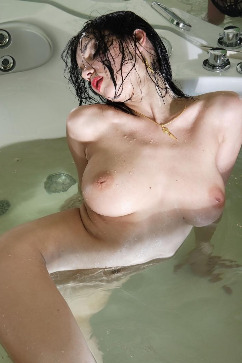 Katie Fey Busty cutie relaxing in a hot bath