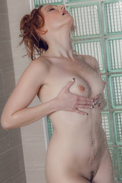 Crystal Clark Redhead playing under the Hot shower