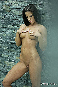 Athina Fit and wet body posing outside