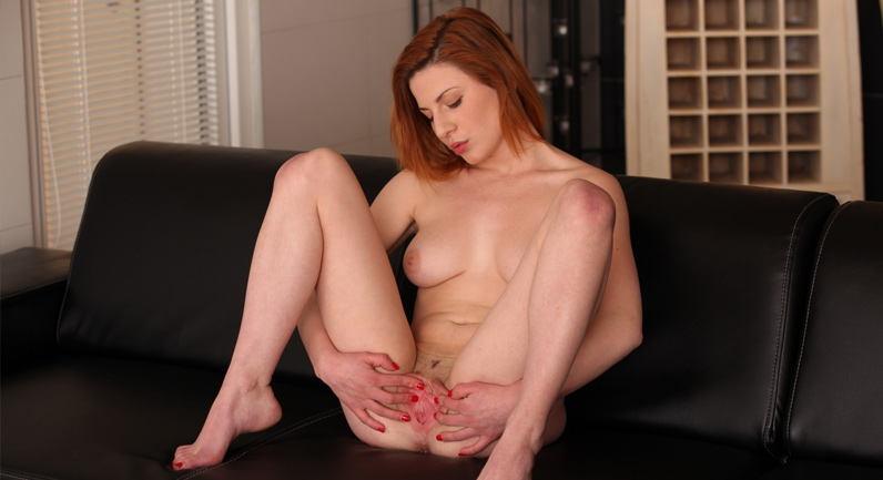 Ritta Red Redhead treats her juicy pussy's sex desire